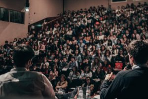 large crowd at auditorium - build an audience