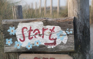 image of a wooden sign that says start