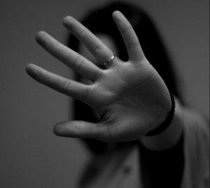 Image of a palm pushing away