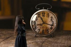 woman staring at a clock