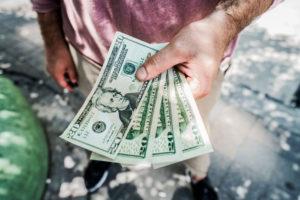 man with 20 dollar bills