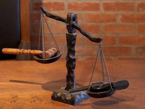 image of scale meaning verdict has been reached