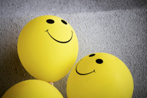 happy face balloons meaning positive