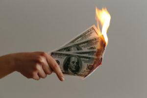 image of burning money